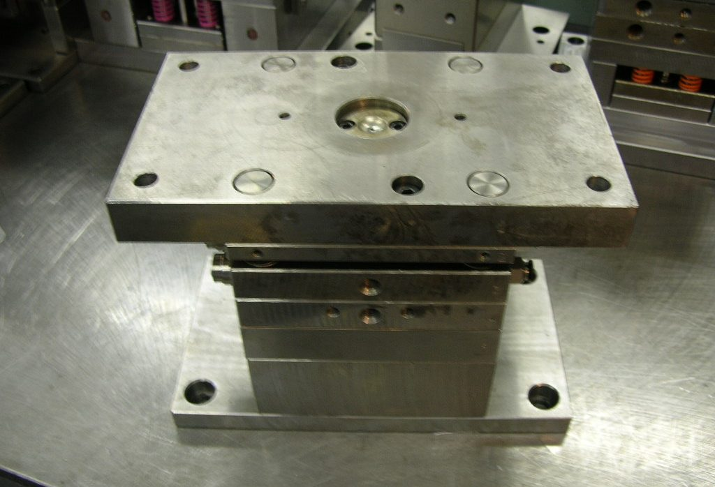 Is there a magnet material that will prevent abrasion of molds?
